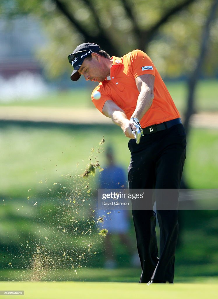 <a gi-track='captionPersonalityLinkClicked' href=/galleries/search?phrase=Brett+Rumford&family=editorial&specificpeople=216614 ng-click='$event.stopPropagation()'>Brett Rumford</a> of Australia plays his second shot at the par 4, first hole during the third round of the 2016 Omega Dubai Desert Classic on the Majlis Course at the Emirates Golf Club on February 6, 2016 in Dubai, United Arab Emirates.