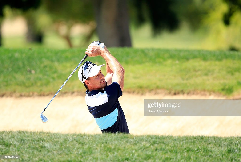 <a gi-track='captionPersonalityLinkClicked' href=/galleries/search?phrase=Brett+Rumford&family=editorial&specificpeople=216614 ng-click='$event.stopPropagation()'>Brett Rumford</a> of Australia plays his second shot at the par 4, first hole during the final round of the 2016 Omega Dubai Desert Classic on the Majlis Course at the Emirates Golf Club on February 7, 2016 in Dubai, United Arab Emirates.