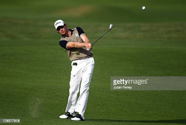 Brett Rumford of Australia plays his second shot on hole 8 during round two of the Madrid Masters Golf at El Encin Golf Hotel on October 7 2011 in...