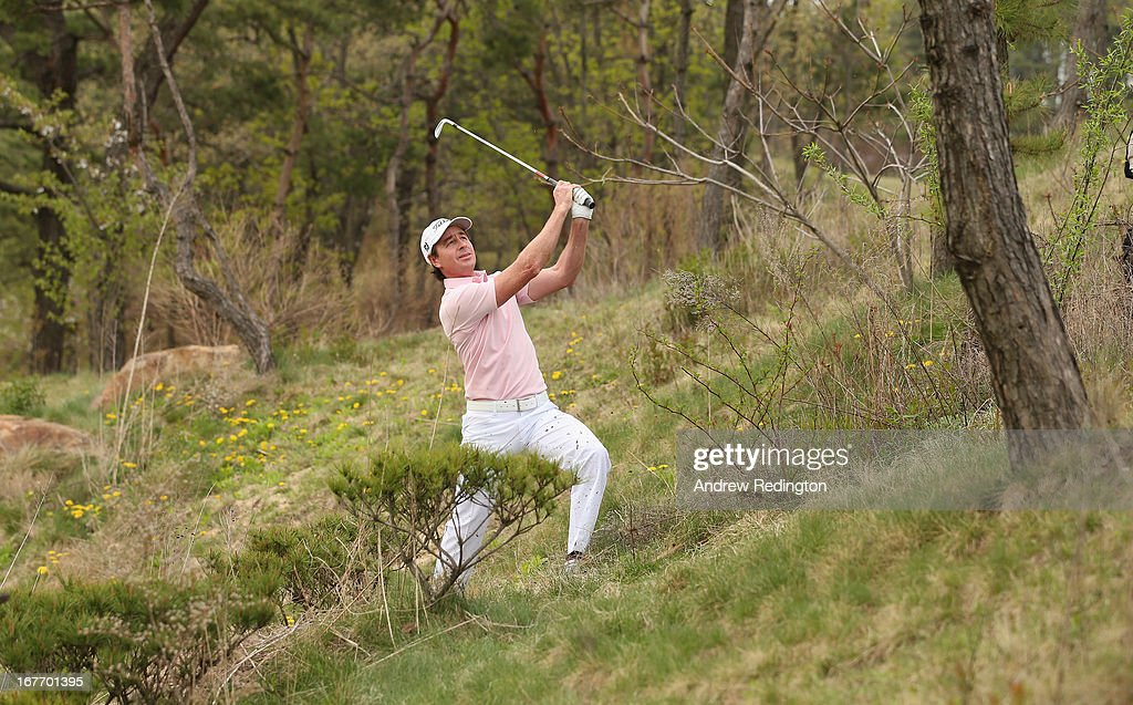 <a gi-track='captionPersonalityLinkClicked' href=/galleries/search?phrase=Brett+Rumford&family=editorial&specificpeople=216614 ng-click='$event.stopPropagation()'>Brett Rumford</a> of Australia plays his third shot on the 17th hole during the final round of the Ballantine's Championship at Blackstone Golf Club on April 28, 2013 in Icheon, South Korea.