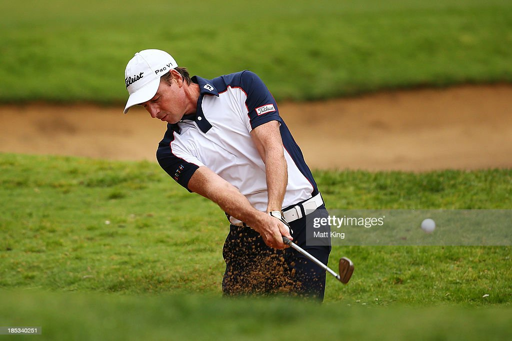 Brett Rumford of Australia plays out of the bunker on the 9th hole during day three of the Perth International at Lake Karrinyup Country Club on October 19, 2013 in Perth, Australia.