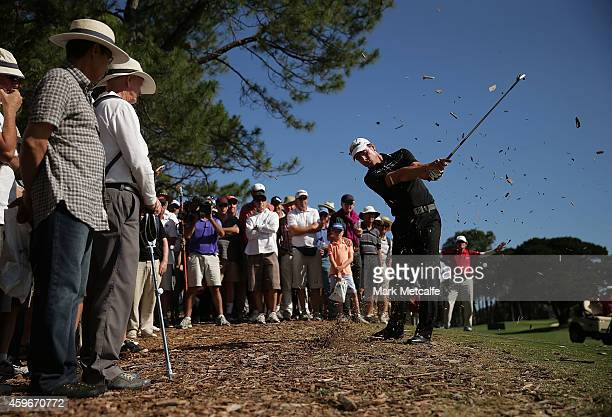 Brett Rumford of Australia plays out of the rough on the 18th hole during day two of the Australian Open at The Australian Golf Course on November 28...