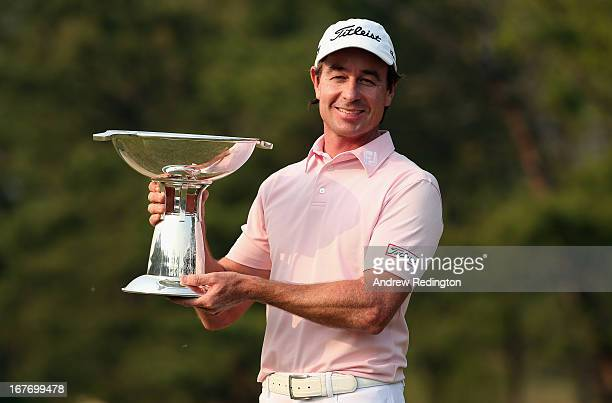 Brett Rumford of Australia poses with the trophy after winning the Ballantine's Championship at Blackstone Golf Club on April 28 2013 in Icheon South...
