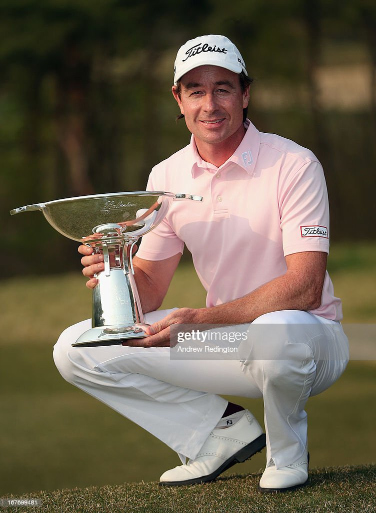 <a gi-track='captionPersonalityLinkClicked' href=/galleries/search?phrase=Brett+Rumford&family=editorial&specificpeople=216614 ng-click='$event.stopPropagation()'>Brett Rumford</a> of Australia poses with the trophy after winning the Ballantine's Championship at Blackstone Golf Club on April 28, 2013 in Icheon, South Korea.