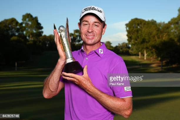 Brett Rumford of Australia poses with the trophy after winning the ISPS HANDA World Super 6 Perth at Lake Karrinyup Country Club on February 19 2017...