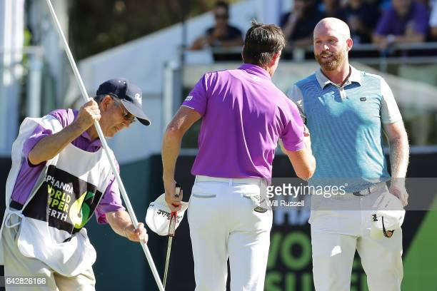 Brett Rumford of Australia shakes hands with Adam Bland of Australia after winning the shootout hole during round four of the ISPS HANDA World Super...