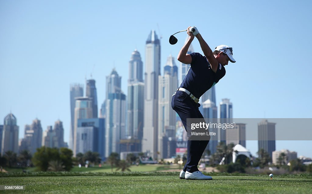 <a gi-track='captionPersonalityLinkClicked' href=/galleries/search?phrase=Brett+Rumford&family=editorial&specificpeople=216614 ng-click='$event.stopPropagation()'>Brett Rumford</a> of Australia tees off on the 8th hole during the final round of the Omega Dubai Desert Classic at the Emirates Golf Club on February 7, 2016 in Dubai, United Arab Emirates.