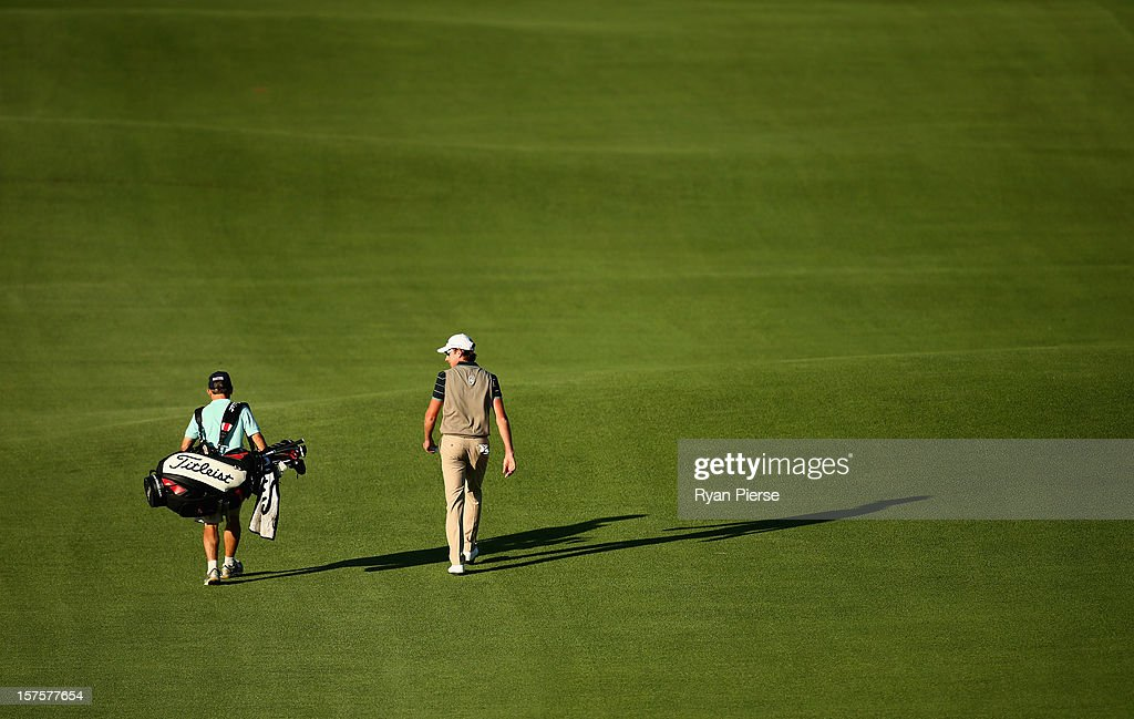 Brett Rumford of Australia walks down the 1st Fairway during the Pro-Am ahead of the 2012 Australian Open, beginning tomorrow, at The Lakes Golf Club on December 5, 2012 in Sydney, Australia.