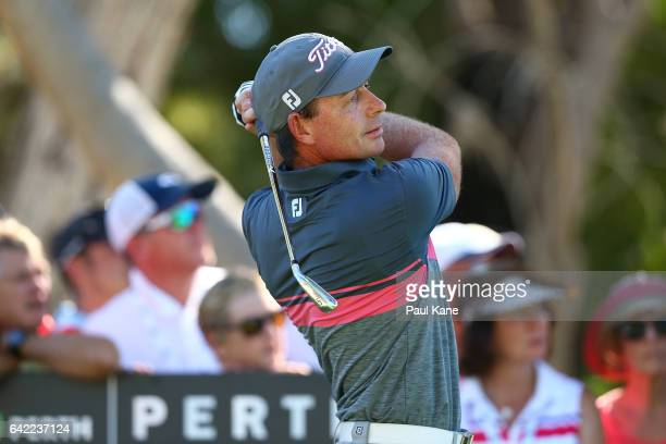 Brett Rumford of Australia watches his tee shot on the 17th hole during round two of the ISPS HANDA World Super 6 Perth at Lake Karrinyup Country...