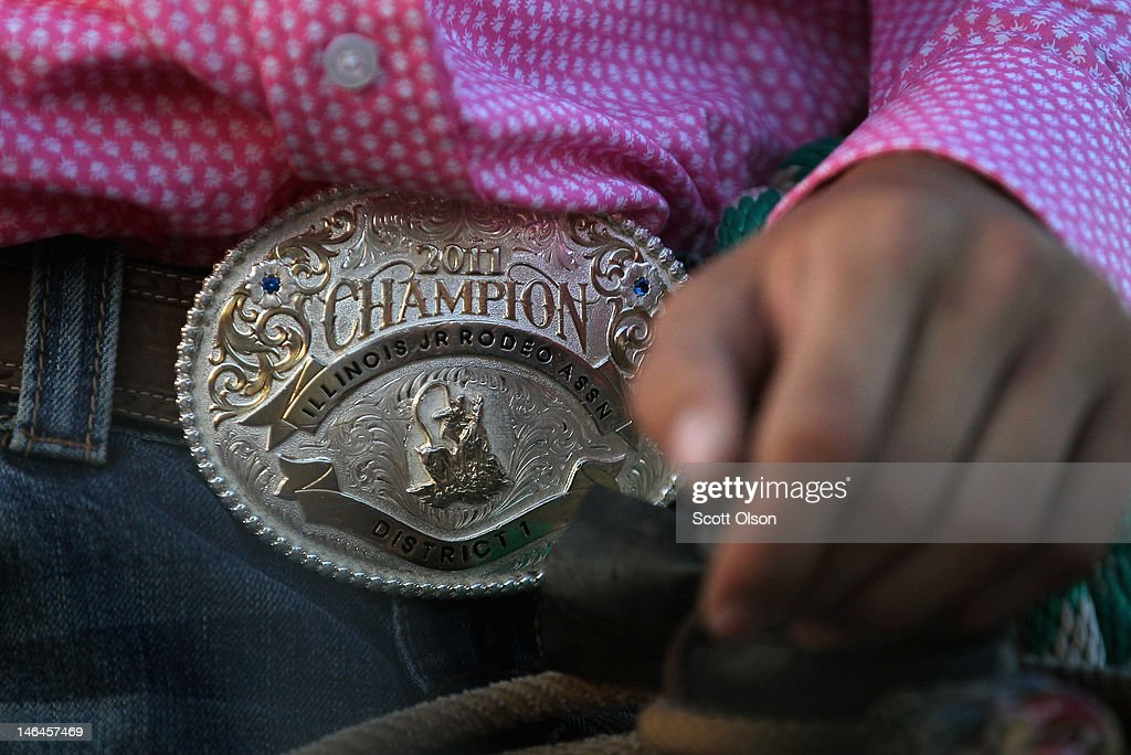 Brett Schewe wears a championship belt buckle from a previous rodeo event while competing at the Illinois High School Rodeo Association State Finals on June 16, 2012 in Altamont, Illinois. Winners in the competition will go on to compete in the high school national championships July 15-21 in Rock Springs, Wyoming.