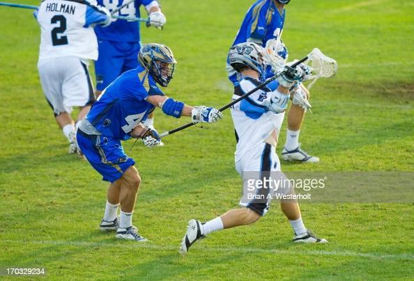 Brett Schmidt of the Charlotte Hounds alters the shot from Jake Bernhardt of the Ohio Machine at American Legion Memorial Stadium on June 8 2013 in...