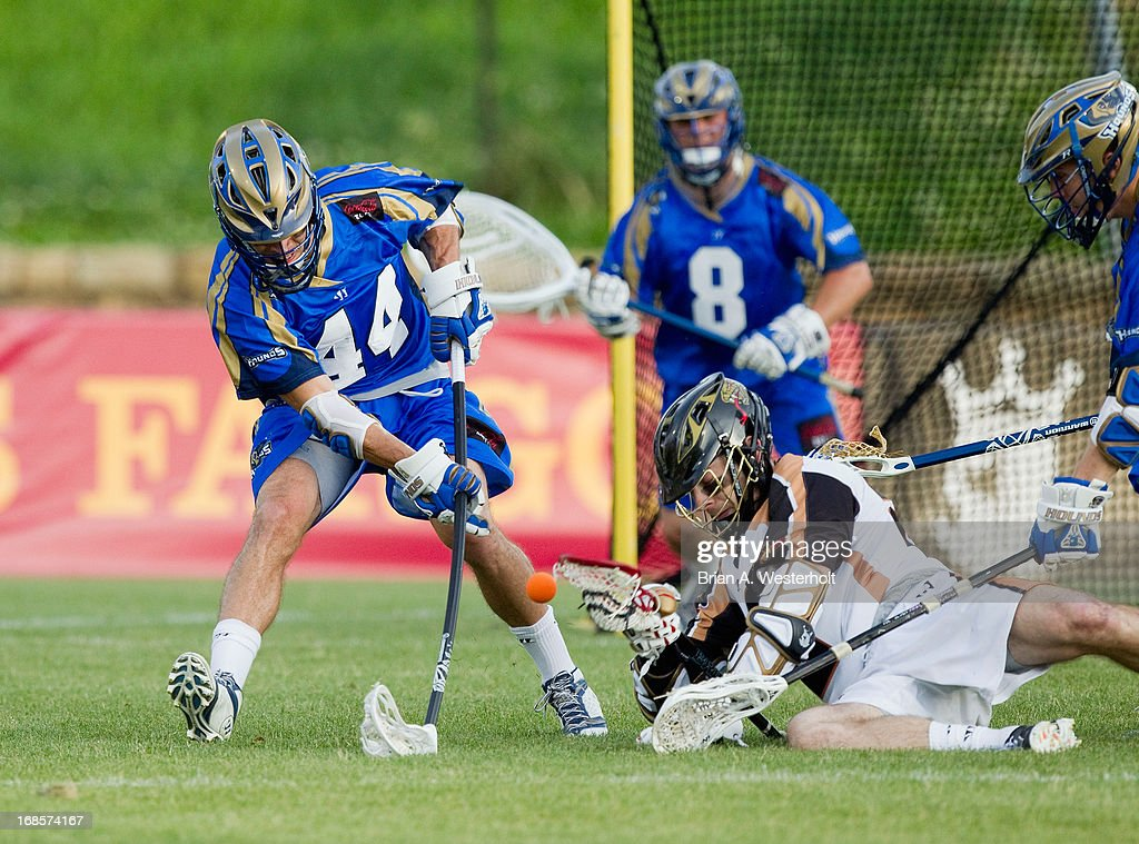 Brett Schmidt #44 of the Charlotte Hounds battles for a ground ball with <a gi-track='captionPersonalityLinkClicked' href=/galleries/search?phrase=Ned+Crotty&family=editorial&specificpeople=4305281 ng-click='$event.stopPropagation()'>Ned Crotty</a> #22 of the Rochester Rattlers during first half action at American Legion Memorial Stadium on May 11, 2013 in Charlotte, North Carolina. The Rattlers defeated the Hounds 13-10.