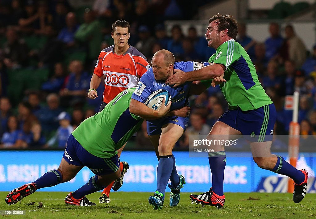 Brett Sheehan of the Force gets tackled during the round 15 Super Rugby match between the Western Force and the Highlanders at nib Stadium on May 25, 2013 in Perth, Australia.