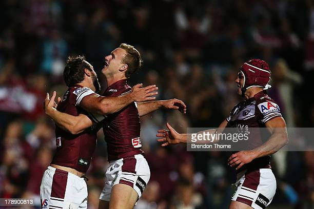 Brett Stewart of the Sea Eagles celebrates with team mate Daly CherryEvans after scoring during the round 25 NRL match between the Manly Sea Eagles...