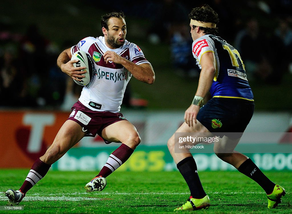 Brett Stewart of the Sea Eagles looks to get past Ethan Lowe of the Cowboys during the round 18 NRL match between the North Queensland Cowboys and the Manly Sea Eagles at 1300SMILES Stadium on July 15, 2013 in Townsville, Australia.