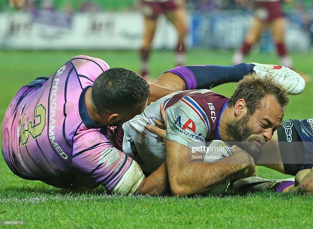 <a gi-track='captionPersonalityLinkClicked' href=/galleries/search?phrase=Brett+Stewart&family=editorial&specificpeople=220234 ng-click='$event.stopPropagation()'>Brett Stewart</a> of the Sea Eagles scores a try during the round nine NRL match between the Melbourne Storm and the Manly-Warringah Sea Eagles at AAMI Park on May 10, 2014 in Melbourne, Australia.