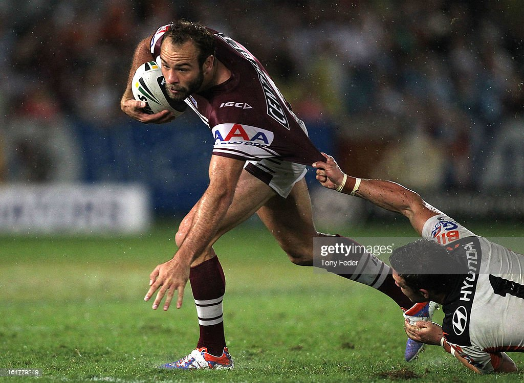 Brett Stewart of the Sea Eagles tries to avoid a tackle by Tim Moltzen of the Wests Tigersduring the round four NRL match between the Manly Sea Eagles and the Wests Tigers at Bluetongue Stadium on March 28, 2013 in Gosford, Australia.