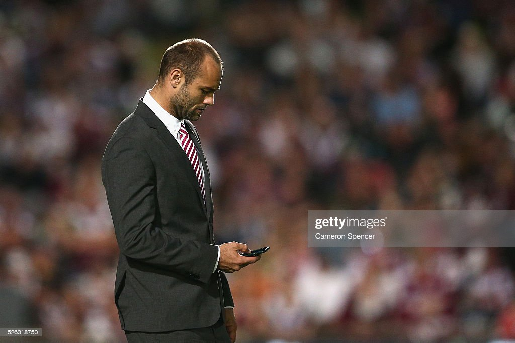 Brett Stewart of the Sea Eagles watches team mates warm up prior to the round nine NRL match between the Manly Sea Eagles and the North Queensland Cowboys at Brookvale Oval on April 30, 2016 in Sydney, Australia.