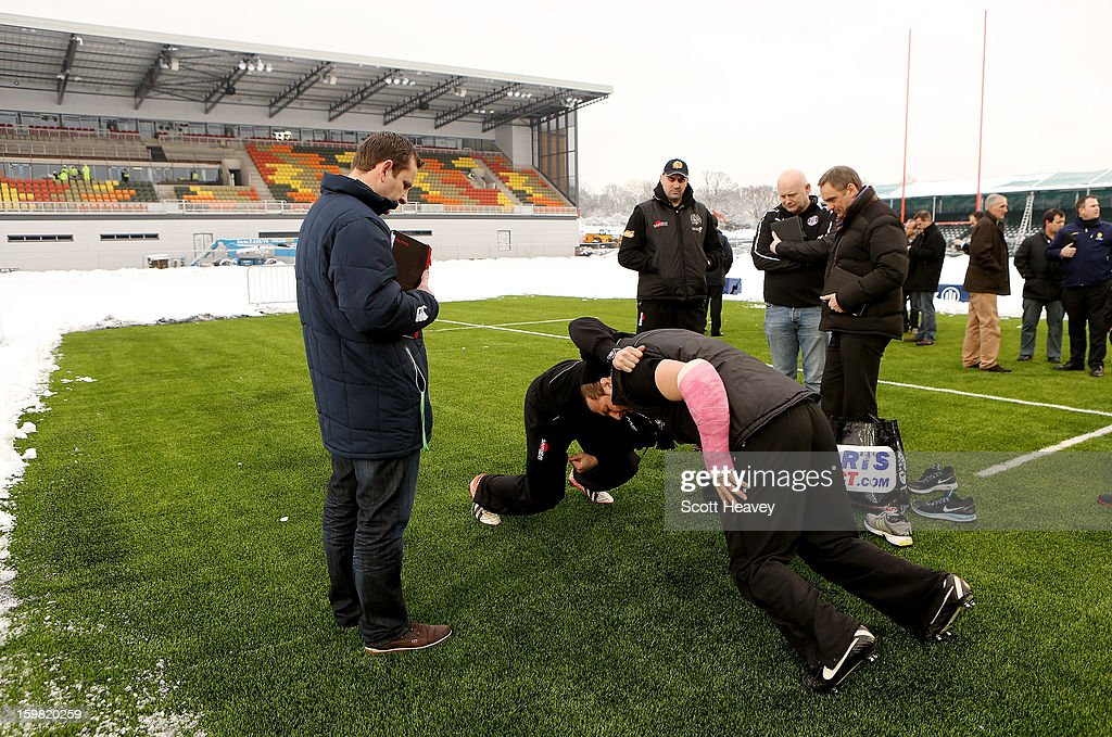 Brett Sturgess (L) and James Parks of Exeter Chiefs test out footwear on the new synthetic pitch during a Saracens media day at Allianz Park on January 21, 2013 in Barnet, England.