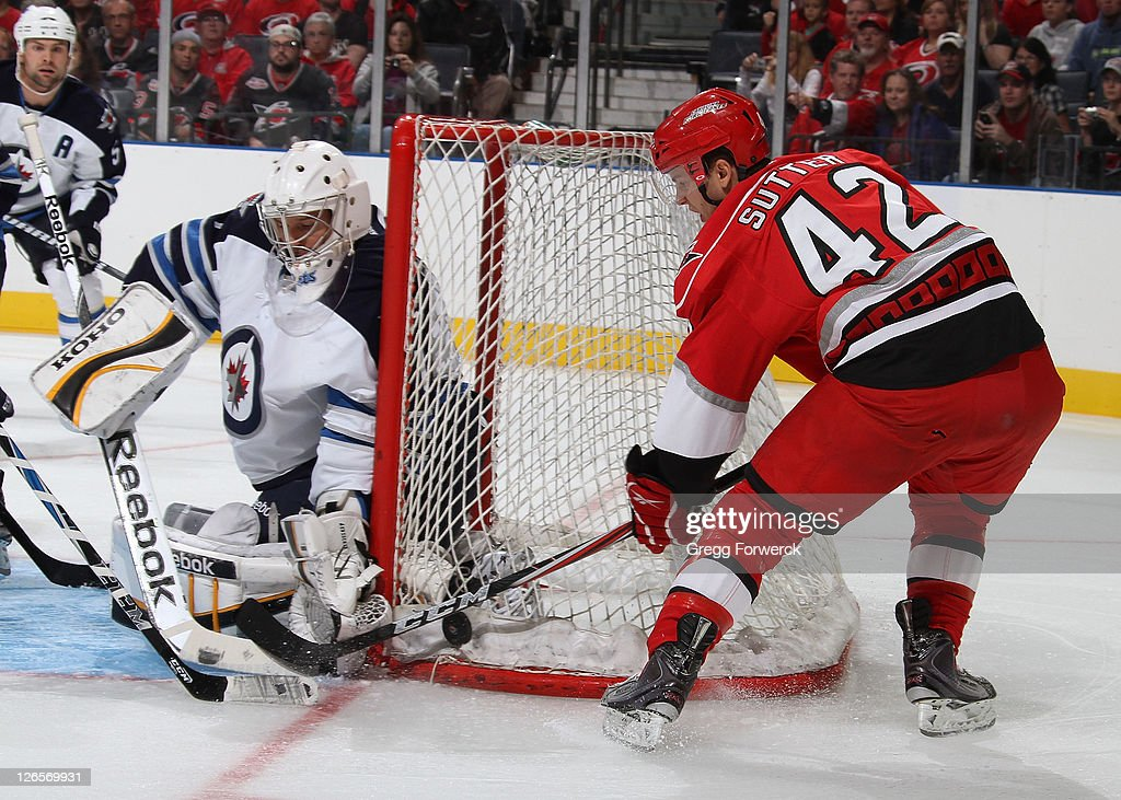 Brett Sutter #42 of the Carolina Hurricanes attempts a wraparound shot during an NHL preseason game against the Winnipeg Jets on September 25, 2011 at Time Warner Arena in Charlotte, North Carolina.
