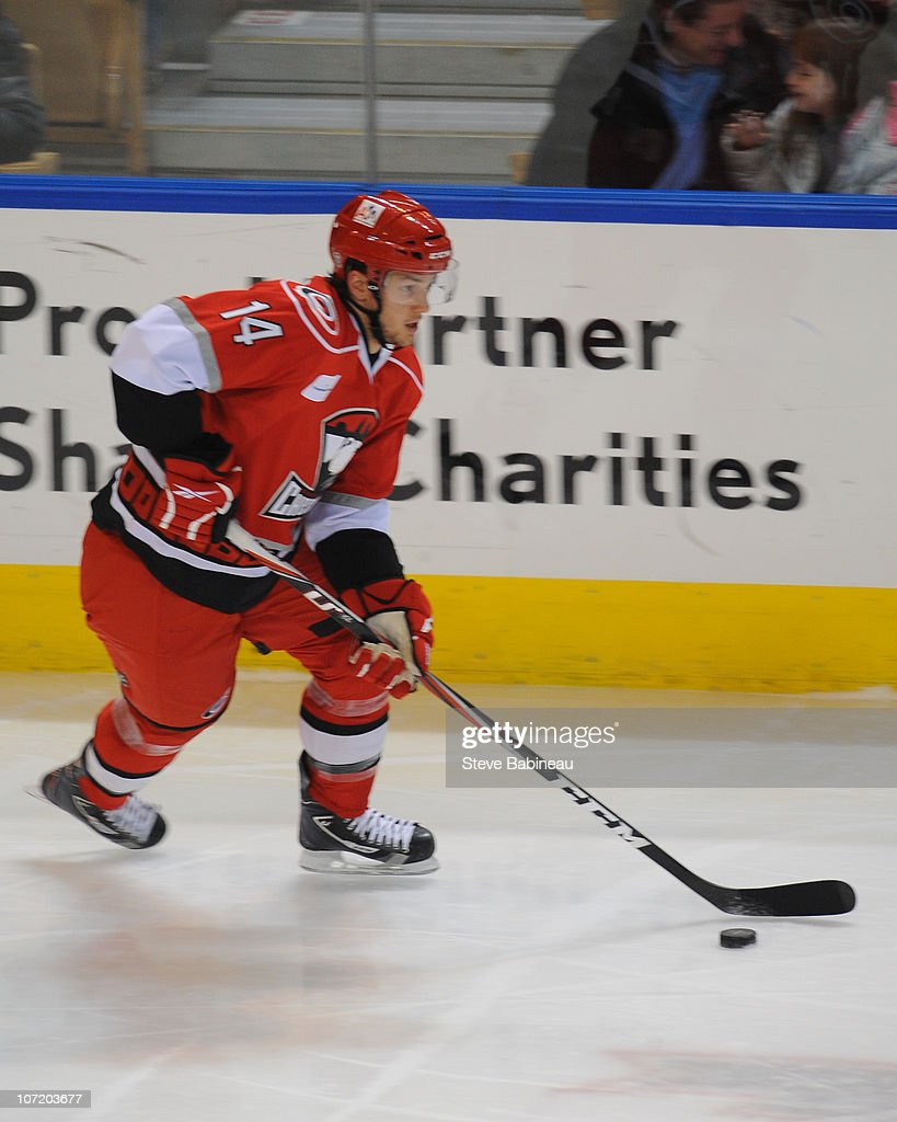 Brett Sutter #14 of the Charlotte Checkers carries the puck in a game against the Worcester Sharks at the DCU Center on November 27, 2010 in Worcester Massachusetts.