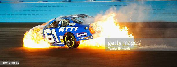 Brett Thompson driver of the Rich Thompson Trucking Chevrolet catches on fire after crashing during the NASCAR KN Pro Series West Casino Arizona 125...