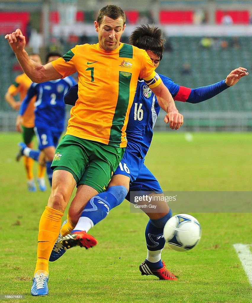 Brett Thwaite of Australia is tackeld by Yang Chao Hsun (R) of Chinese Taipei during the EAFF East Asian Cup 2013 Qualifying match between Chinese Tapei and the Australian Socceroos at Hong Kong Stadium on December 9, 2012 in So Kon Po, Hong Kong.