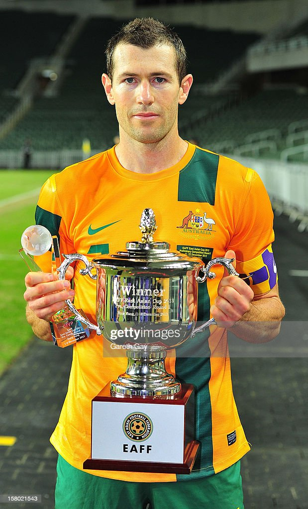 Brett Thwaite of Australia poses with the trophy after victory in the EAFF East Asian Cup 2013 Qualifying match between Chinese Tapei and the Australian Socceroos at Hong Kong Stadium on December 9, 2012 in So Kon Po, Hong Kong.
