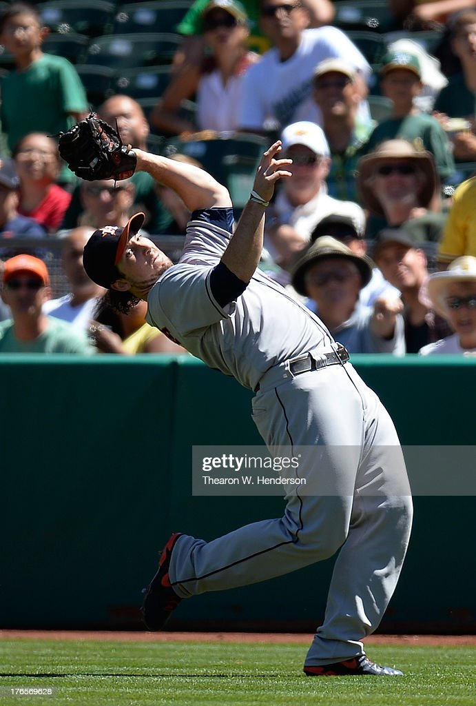 <a gi-track='captionPersonalityLinkClicked' href=/galleries/search?phrase=Brett+Wallace&family=editorial&specificpeople=2364861 ng-click='$event.stopPropagation()'>Brett Wallace</a> #29 of the Houston Astros battles the sun to catch this foul pop-up off the bat of Derek Norris (not pictured) of the Oakland Athletics in the third inning at O.co Coliseum on August 15, 2013 in Oakland, California.