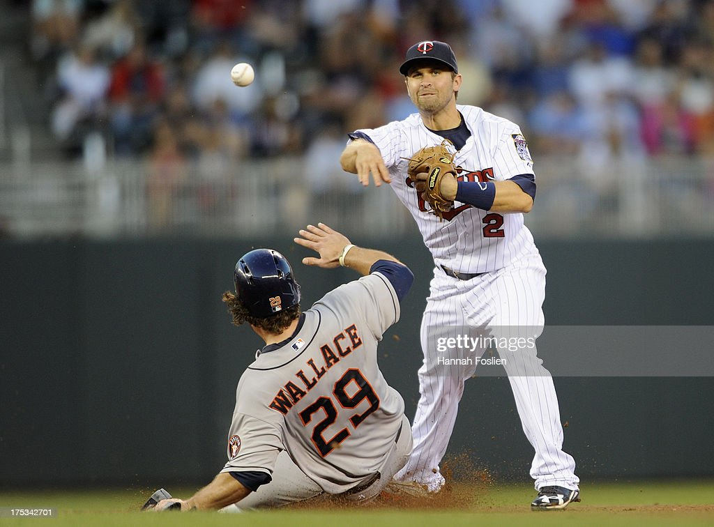 Brett Wallace #29 of the Houston Astros is out at second base as Brian Dozier #2 of the Minnesota Twins turns a double play during the fourth inning of the game on August 2, 2013 at Target Field in Minneapolis, Minnesota.