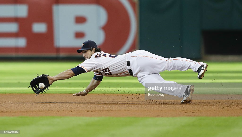 Brett Wallace #29 of the Houston Astros makes a diving stop on ground ball hit by Matt Joyce #20 of the Tampa Bay Rays in the first inning at Minute Maid Park on July 3, 2013 in Houston, Texas. Wallace was unable to keep the ball in his glove and runner was safe.
