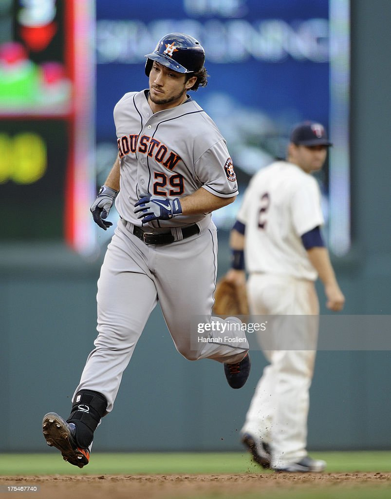 Brett Wallace #29 of the Houston Astros rounds the bases after hitting a solo home run as Brian Dozier #2 of the Minnesota Twins looks on during the third inning of the game on August 3, 2013 at Target Field in Minneapolis, Minnesota.
