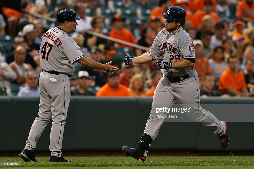 <a gi-track='captionPersonalityLinkClicked' href=/galleries/search?phrase=Brett+Wallace&family=editorial&specificpeople=2364861 ng-click='$event.stopPropagation()'>Brett Wallace</a> #29 of the Houston Astros rounds the bases, and high-fives third base coach Dave Trembley #47, after hitting a home run in the second inning against the Baltimore Orioles at Oriole Park at Camden Yards on August 1, 2013 in Baltimore, Maryland.