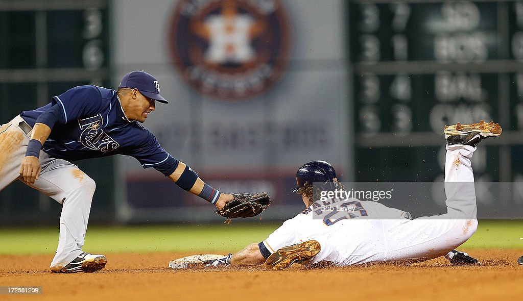 Brett Wallace #29 of the Houston Astros slides safely into second base before Yunel Escobar #11 of the Tampa Bay Rays can apply the tag in the seventh inning at Minute Maid Park on July 3, 2013 in Houston, Texas.