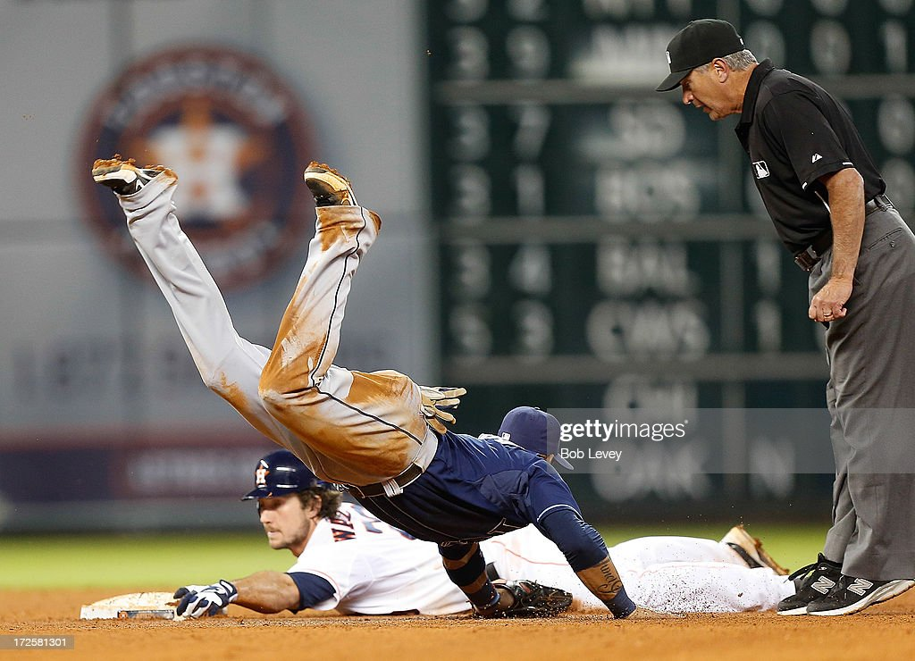 Brett Wallace #29 of the Houston Astros slides safely into second base before Yunel Escobar #11 of the Tampa Bay Rays can apply the tag as umpire John Hirschbeck calls time in the seventh inning at Minute Maid Park on July 3, 2013 in Houston, Texas.