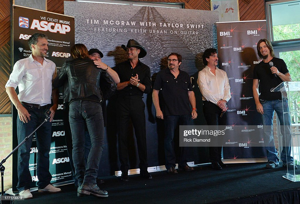 Brett Warren, Keith Urban, Mark Irwin, Tim McGraw, Byron Gallimore, <a gi-track='captionPersonalityLinkClicked' href=/galleries/search?phrase=Scott+Borchetta&family=editorial&specificpeople=4462508 ng-click='$event.stopPropagation()'>Scott Borchetta</a> and <a gi-track='captionPersonalityLinkClicked' href=/galleries/search?phrase=Brad+Warren&family=editorial&specificpeople=212917 ng-click='$event.stopPropagation()'>Brad Warren</a> Celebrate Tim McGraw's Multi-Week No.1 'Highway Don't Care' at Music City Tippler on August 20, 2013 in Nashville City.