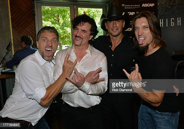 Brett Warren Scott Borchetta Tim McGraw and Brad Warren attend as Tim McGraw Celebrates MultiWeek No 1 'Highway Don't Care' at Music City Tippler on...