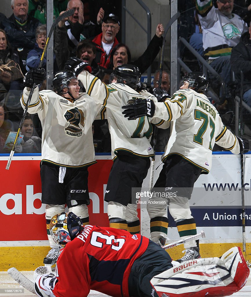 Brett Welychka #27 of the London Knights celebrates his hat trick goal with his teammates in an OHL game against the Windsor Spitfires on December 27, 2012 at the Budweiser Gardens in London, Canada. The Knights defeated the Spitfires 9-4 to extend their winning streak to 22 games.