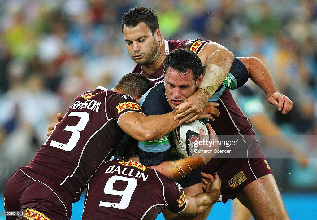 Brett White of the Blues is tackled during game one of the ARL State of Origin series between the New South Wales Blues and the Queensland Maroons at ANZ Stadium on May 26, 2010 in Sydney, Australia.