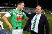 Brett White of the Raiders embraces coach Ricky Stuart following the round 26 NRL match between the Canberra Raiders and the Parramatta Eels at GIO...