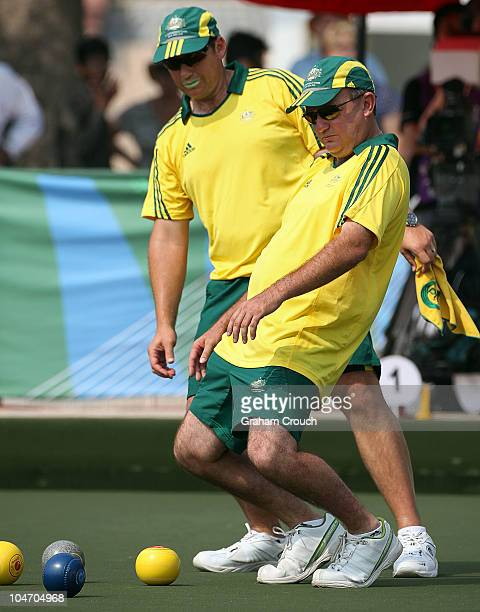 Brett Wilkie of Australia watches intently with team mate Wayne Turley during the Mens Triples section of the Lawn bowls game against host nation...