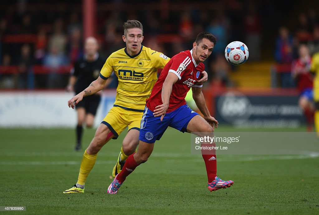 Brett Williams of Aldershot battles with Angus MacDonald of Torquay during the FA Cup Qualifying Fourth Round match bteween Aldershot Town and...