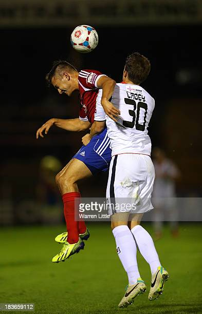 Brett Williams of Aldershot is tackled by Alex Lacey of Luton during the Skrill Conference Premier match between Aldershot Town and Luton Town at...