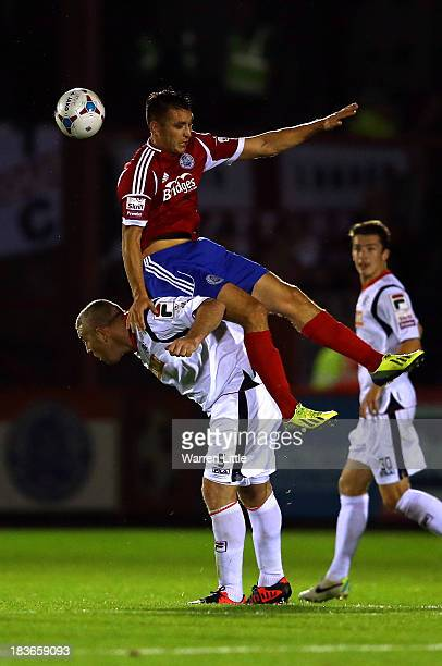 Brett Williams of Aldershot is tackled by Steve McNulty of Luton during the Skrill Conference Premier match between Aldershot Town and Luton Town at...