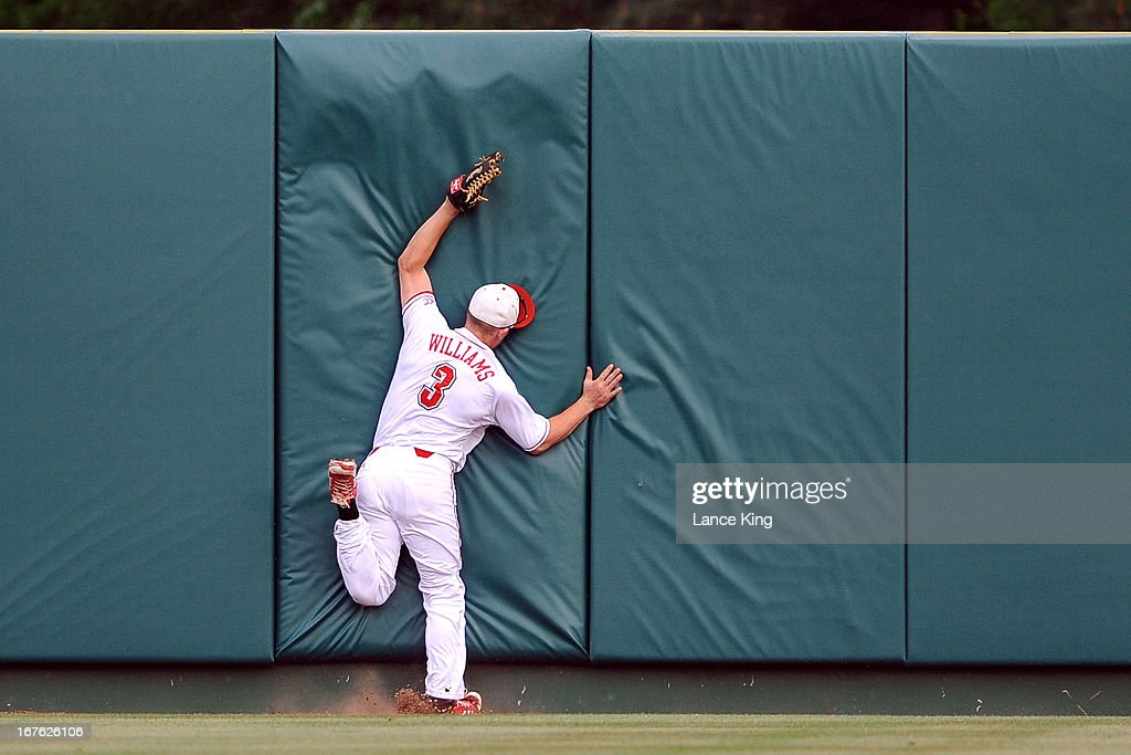 Brett Williams #3 of the North Carolina State Wolfpack runs into the center field wall during a game against the North Carolina Tar Heels at Doak Field on April 26, 2013 in Raleigh, North Carolina. North Carolina defeated NC State 7-1.