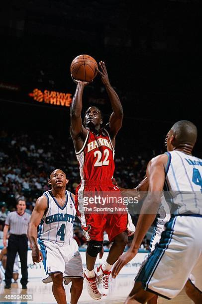 Brevin Knight of the Atlanta Hawks goes up for a shot over David Wesley of the Charlotte Hornets during the game on April 16 2001 at Charlotte...