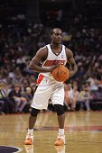 Brevin Knight of the Charlotte Bobcats looks to pass during a game against the Miami Heat at the Charlotte Bobcats Arena on November 25 2006 in...