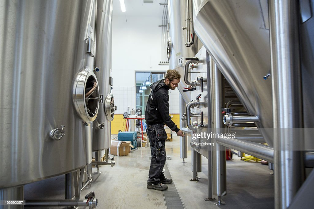 A brewer adjusts a control panel in the brewing room at the 'New Carnegie Brewery,' also known as Nya Carnegibryggeriet, operated by Brooklyn Brewery Corp. in collaboration with D. Carnegie & Co., the Swedish unit of Carlsberg A/S, stands in Stockholm, Sweden, on Friday, Jan. 31, 2014. Brooklyn has teamed up with the Swedish unit of Carlsberg A/S, D. Carnegie & Co. and a few private investors to create 'The New Carnegie Brewery,' with an annual capacity of 1 million liters. Photographer: Casper Hedberg/Bloomberg via Getty Images