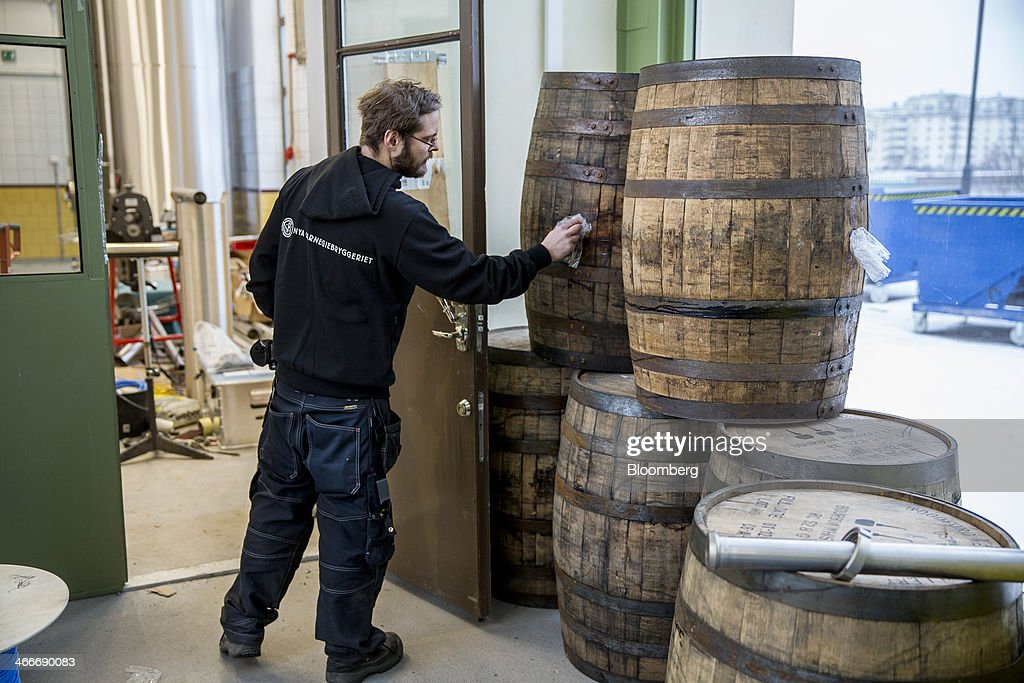 A brewer cleans the outside of an old whisky barrel used to store speciality beers at the 'New Carnegie Brewery,' also known as Nya Carnegibryggeriet, operated by Brooklyn Brewery Corp. in collaboration with D. Carnegie & Co., the Swedish unit of Carlsberg A/S, stands in Stockholm, Sweden, on Friday, Jan. 31, 2014. Brooklyn has teamed up with the Swedish unit of Carlsberg A/S, D. Carnegie & Co. and a few private investors to create 'The New Carnegie Brewery,' with an annual capacity of 1 million liters. Photographer: Casper Hedberg/Bloomberg via Getty Images