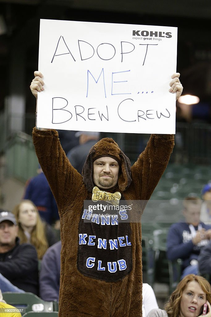 A Brewer fan in a dog costume holds up an adoption sign during the game against the Pittsburgh Pirates at Miller Park on May 13, 2014 in Milwaukee, Wisconsin.